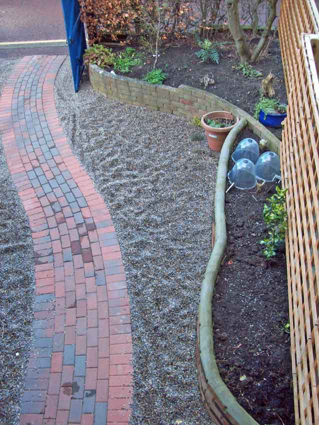 New drive raised bed with gravel surface and winding brick path, early March 2014